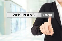 Businesswoman hand touching 2019 business plans on search bar ov stock illustration