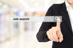 Businesswoman hand touching job search on search bar over blur b. Ackground, business and technology concept, search engine optimization, web banner Stock Images