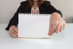 Businesswoman hand turning page of notebook Royalty Free Stock Images