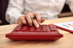 Businesswoman hand using  calculator Stock Images