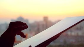 Businesswoman hand using tablet in the office with glass window over city at beautiful sunset. 4k stock video