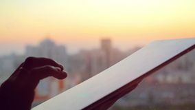 Businesswoman hand using tablet in the office with glass window over city at beautiful sunset. 1920x1080 stock footage