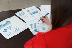Businesswoman hand working with business graph or analysis chart. Close up business team analysis and strategy concept. Royalty Free Stock Image