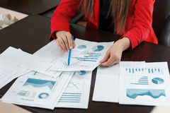 Businesswoman hand working with business graph or analysis chart. Close up business team analysis and strategy concept. Stock Image