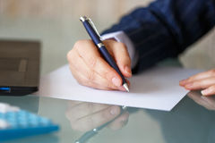 Businesswoman hand write on blank paper Royalty Free Stock Image