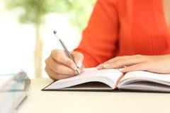 Businesswoman hand writing in agenda Royalty Free Stock Photo