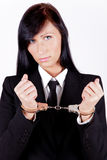 Businesswoman handcuffed. Handcuffed bank businesswoman being sad Royalty Free Stock Photography