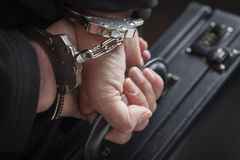 Businesswoman In Handcuffs Carrying Briefcase Royalty Free Stock Image