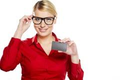 Businesswoman handing a blank business card Stock Photography