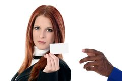 Businesswoman Handing Card Over Shoulder royalty free stock image