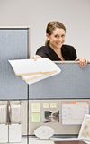 Businesswoman handing co-worker file folder Stock Images