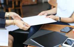 Businesswoman are handing a contract. Documents agreement Stock Photo