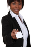 Businesswoman handing out card Royalty Free Stock Photo