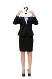 Businesswoman handing question mark in front of face Stock Image
