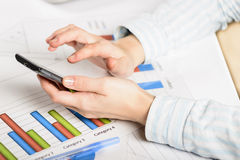 Businesswoman hands analyzing financial statistics. Royalty Free Stock Images