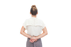Businesswoman with hands behind her back Stock Photography