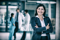Businesswoman with hands folded. Portrait of businesswoman standing with hands folded at hospital stock images
