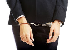 Businesswoman hands with handcuffs Stock Photo