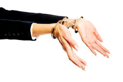 Businesswoman hands with handcuffs Stock Photos