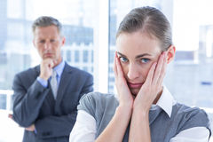 Businesswoman with hands on her face Royalty Free Stock Photos