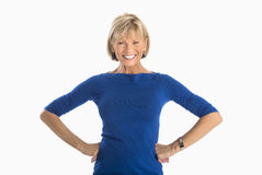 Businesswoman With Hands On Hip Over White Background Royalty Free Stock Photos
