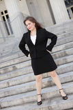 Businesswoman with hands on hips Stock Photography