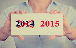 Businesswoman hands holding sign with year 2014 crossed and 2015 marked Royalty Free Stock Photos