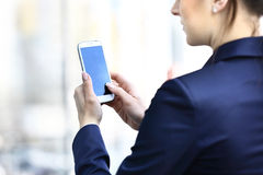Businesswoman hands holding smartphone Stock Image
