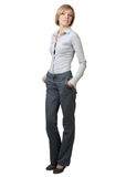 Businesswoman with hands in pockets Stock Photos
