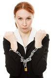 Businesswoman with hands shackled in chains. Stock Photography