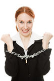 Businesswoman with hands shackled in chains. Royalty Free Stock Image