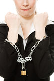 Businesswoman with hands shackled in chains. Royalty Free Stock Photo