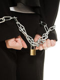 Businesswoman with hands shackled in chains. Stock Photos