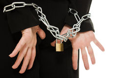 Businesswoman with hands shackled in chains. Royalty Free Stock Photos