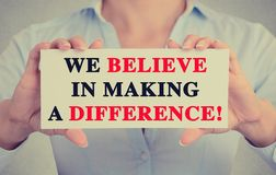 Businesswoman hands sign with We Believe in Making a Difference message Stock Images