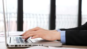 Businesswoman hands typing on the laptop keyboard. Close up footage stock footage