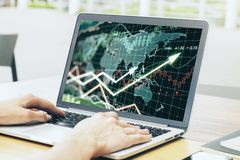 Businesswoman hands using laptop computer with forex chart. Side view of businesswoman hands using laptop computer with forex chart. Blurry street background Stock Photos