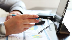 Businesswoman hands working with charts on tablet computer