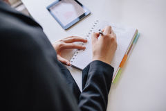 Businesswoman hands writing on notepad Royalty Free Stock Photos