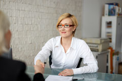 Businesswoman handshake with costumer Royalty Free Stock Image