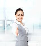 Businesswoman handshake in modern office Stock Images