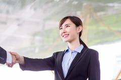 Businesswoman handshake with smile. Businesswoman handshake  with confident smile after a meeting royalty free stock photo