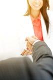 Businesswoman handshaking with a businessman Stock Photos