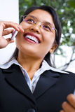 Businesswoman in happily talking on phone Royalty Free Stock Image