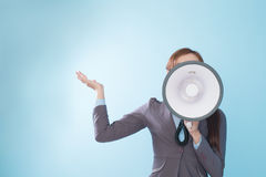 Businesswoman happy with a megaphone Stock Images