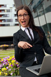 Businesswoman happy pointing her finger at laptop Royalty Free Stock Image