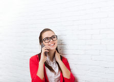 Businesswoman happy smile cell phone call problem wear red jacket glasses talking on mobile look up to copy space Royalty Free Stock Photos