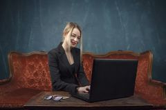 Businesswoman, happy woman in suit smiling using laptop for work in vintage interior Stock Images