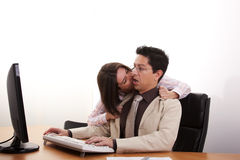 Businesswoman harassment. At her partner pushing his necktie Stock Photo