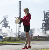 Businesswoman with hard hat outside steelworks Stock Images